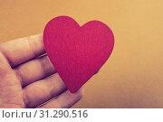 Купить «Red color heart shaped object in hand on dotted paper», фото № 31290516, снято 12 марта 2018 г. (c) easy Fotostock / Фотобанк Лори