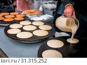 Купить «Men preparing delicious pancakes on the street food market in Bergen, Norway», фото № 31315252, снято 9 апреля 2020 г. (c) easy Fotostock / Фотобанк Лори
