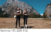 Купить «Two young women running towards the camera holding a football ball - Dolomites, Italy», видеоролик № 31324112, снято 29 мая 2020 г. (c) Константин Шишкин / Фотобанк Лори