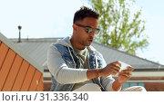 Купить «man playing game on smartphone on roof top», видеоролик № 31336340, снято 30 июня 2019 г. (c) Syda Productions / Фотобанк Лори
