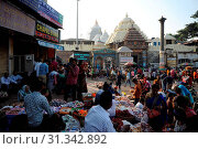 Купить «Busy street market in the late afternoon outside the Jagannath Temple, Puri, Odisha, India, Asia», фото № 31342892, снято 15 ноября 2018 г. (c) age Fotostock / Фотобанк Лори