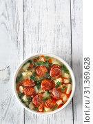 Купить «Portion of Portuguese Caldo verde soup», фото № 31369628, снято 17 марта 2019 г. (c) easy Fotostock / Фотобанк Лори