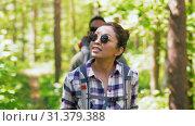 Купить «group of friends with backpacks hiking in forest», видеоролик № 31379388, снято 29 июня 2019 г. (c) Syda Productions / Фотобанк Лори
