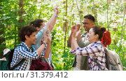 Купить «friends with backpacks hiking and making high five», видеоролик № 31379412, снято 29 июня 2019 г. (c) Syda Productions / Фотобанк Лори