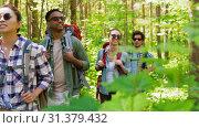 Купить «group of friends with backpacks hiking in forest», видеоролик № 31379432, снято 29 июня 2019 г. (c) Syda Productions / Фотобанк Лори