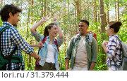 Купить «friends with backpacks hiking and making high five», видеоролик № 31379444, снято 29 июня 2019 г. (c) Syda Productions / Фотобанк Лори