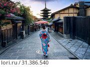 Купить «Asian woman wearing japanese traditional kimono at Yasaka Pagoda and Sannen Zaka Street in Kyoto, Japan.», фото № 31386540, снято 31 июля 2018 г. (c) easy Fotostock / Фотобанк Лори