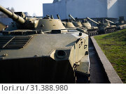 Купить «Parts of the hull of the armored infantry vehicle. In front and back of vehicle stays many different armored military vehicles. Military equipment outdoor open air museum.», фото № 31388980, снято 10 ноября 2018 г. (c) easy Fotostock / Фотобанк Лори