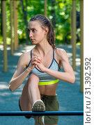 Купить «outdoor exercise, portrait of a sports woman on the sports field», фото № 31392592, снято 31 июля 2018 г. (c) Константин Лабунский / Фотобанк Лори