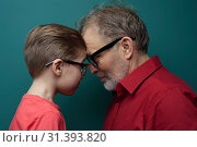 Купить «Close-up grandfather and grandson with glasses», фото № 31393820, снято 10 марта 2019 г. (c) Pavel Biryukov / Фотобанк Лори
