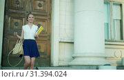 Купить «European foreign education concept. Happy girl student leaves university», видеоролик № 31394024, снято 8 июля 2019 г. (c) Gennadiy Poznyakov / Фотобанк Лори