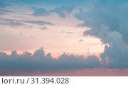 Купить «Colorful cloudy tropical sky at sunset», фото № 31394028, снято 22 марта 2019 г. (c) EugeneSergeev / Фотобанк Лори