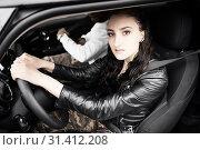 Купить «Woman in car behind steering wheel, in Munich, Germany», фото № 31412208, снято 12 мая 2019 г. (c) age Fotostock / Фотобанк Лори