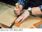 Купить «Concept of handmade craft production of leather goods.», фото № 31422252, снято 13 марта 2019 г. (c) Jan Jack Russo Media / Фотобанк Лори