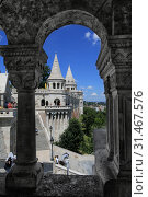 Купить «Hungary, Budapest, June 3, 2019. View of the Fisherman's Bastion one of the attractions of Budapest from the arch of the tower», фото № 31467576, снято 3 июня 2019 г. (c) Яна Королёва / Фотобанк Лори