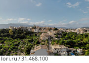 Aerial photo drone point of view image Campanet town hillside residential old ancient houses building exterior situated in the northeast of Majorca Island, Spain, (2019 год). Стоковое фото, фотограф Alexander Tihonovs / Фотобанк Лори