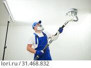 Купить «Painter work with ceiling. polishing and sanding the surface after putty for painting», фото № 31468832, снято 11 июня 2019 г. (c) Дмитрий Калиновский / Фотобанк Лори