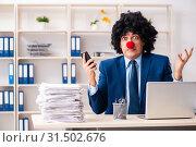 Купить «Young clown businessman working in the office», фото № 31502676, снято 14 декабря 2018 г. (c) Elnur / Фотобанк Лори