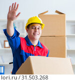 Купить «Young man working in relocation services with boxes», фото № 31503268, снято 30 июня 2017 г. (c) Elnur / Фотобанк Лори