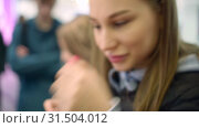 Купить «Pretty young women try liquid lipstick color on her hand, show it to her friend», видеоролик № 31504012, снято 2 июля 2019 г. (c) Ирина Мойсеева / Фотобанк Лори