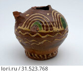 Купить «Pottery jug decorated with sludge technology in yellow and green, oil can jar jar foundations ceramic earthenware clay engobe glaze lead glaze, hand turned...», фото № 31523768, снято 4 ноября 2018 г. (c) age Fotostock / Фотобанк Лори