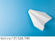 Flat lay of white paper plane and blank paper on pastel blue color background. Стоковое фото, фотограф Евдокимов Максим / Фотобанк Лори