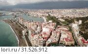 Купить «Panoramic view of Mediterranean coastal city of Malaga with harbor, Spain», видеоролик № 31526912, снято 18 апреля 2019 г. (c) Яков Филимонов / Фотобанк Лори
