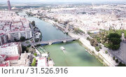 Купить «Aerial view Sevilla of city center with embankment of Guadalquivir. Spain», видеоролик № 31526916, снято 19 апреля 2019 г. (c) Яков Филимонов / Фотобанк Лори