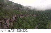 Купить «Уральские горы. Розовые скалы в тумане. Ural Mountains. Pink rocks in the mist.», видеоролик № 31529332, снято 12 июля 2019 г. (c) Евгений Романов / Фотобанк Лори