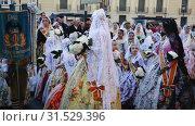 Купить «Falleres in colorful historic dresses parading through city streets during traditional Falles celebration», видеоролик № 31529396, снято 18 марта 2019 г. (c) Яков Филимонов / Фотобанк Лори