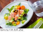 Купить «Ceviche from salmon on plate with cumquat, green dill and avocado», фото № 31531252, снято 21 октября 2019 г. (c) Яков Филимонов / Фотобанк Лори