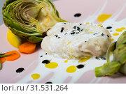 Купить «Tasty fillet of horse-mackerel with artichokes and sauce on plate», фото № 31531264, снято 18 июля 2019 г. (c) Яков Филимонов / Фотобанк Лори
