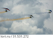 Купить «Ultralight trikes performing in sky on air show», фото № 31531272, снято 20 мая 2018 г. (c) Яков Филимонов / Фотобанк Лори