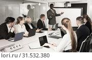 Купить «African American male speaker giving talk on corporate business», фото № 31532380, снято 10 марта 2018 г. (c) Яков Филимонов / Фотобанк Лори