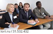 Купить «Group of business people listening to presentation», фото № 31532432, снято 12 февраля 2018 г. (c) Яков Филимонов / Фотобанк Лори