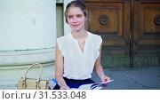 Купить «Higher education dreaming girl freshwoman student sitting on university steps», видеоролик № 31533048, снято 9 июля 2019 г. (c) Gennadiy Poznyakov / Фотобанк Лори