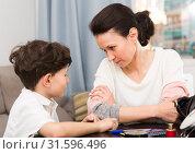 Купить «Serious woman talking with son», фото № 31596496, снято 28 марта 2019 г. (c) Яков Филимонов / Фотобанк Лори