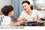 Купить «Cheerful woman telling story to son», фото № 31596504, снято 28 марта 2019 г. (c) Яков Филимонов / Фотобанк Лори