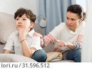 Купить «Troubled boy and mother scolding him», фото № 31596512, снято 28 марта 2019 г. (c) Яков Филимонов / Фотобанк Лори