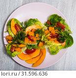 Купить «Salad of baked pumpkin, cherry tomatoes, sesame, sauce and greens», фото № 31596636, снято 22 июля 2019 г. (c) Яков Филимонов / Фотобанк Лори