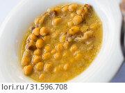 Купить «Stewed chickpeas with Iberian bacon», фото № 31596708, снято 16 октября 2018 г. (c) Яков Филимонов / Фотобанк Лори