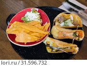 Купить «Mexican tacos and nachos with guacamole», фото № 31596732, снято 24 августа 2019 г. (c) Яков Филимонов / Фотобанк Лори