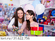 Купить «woman and active daughter with gifts and balloons in the shop», фото № 31622756, снято 22 января 2018 г. (c) Яков Филимонов / Фотобанк Лори
