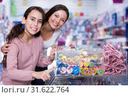 Купить «Woman with smiling girl choosing candies in shop», фото № 31622764, снято 22 января 2018 г. (c) Яков Филимонов / Фотобанк Лори