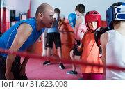 Купить «Teenagers training at boxing workout on boxing ring», фото № 31623008, снято 12 апреля 2017 г. (c) Яков Филимонов / Фотобанк Лори