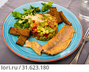 Купить «Salad from avocado, tomatoes and greens with trout», фото № 31623180, снято 21 июля 2019 г. (c) Яков Филимонов / Фотобанк Лори
