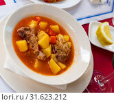 Купить «Delicious lamb soup with potatoes. Traditional oriental dish», фото № 31623212, снято 21 сентября 2019 г. (c) Яков Филимонов / Фотобанк Лори