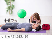 Купить «Young man feeling bad during training in first aid concept», фото № 31623480, снято 10 мая 2019 г. (c) Elnur / Фотобанк Лори