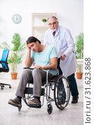 Купить «Male patient in wheel-chair visiting old doctor», фото № 31623868, снято 3 апреля 2019 г. (c) Elnur / Фотобанк Лори