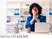 Купить «Young clown businessman working in the office», фото № 31624500, снято 14 декабря 2018 г. (c) Elnur / Фотобанк Лори